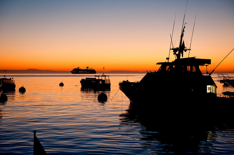 Sunrise in Avalon Harbor, Catalina Island, California. A cruise ship anchored out the night before. Taken Sept. 26, 2011 with a Nikon D700.