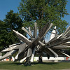 The Albright-Knox Art Gallery's Elmwood Avenue exterior, with Stainless Steel, Aluminum, Monochrome I, Built to Live Anywhere, at Home Here, 2010–11, by Nancy Rubins (American, born 1952); stainless steel, stainless steel wire, and aluminum, 360 x 576 x 420 inches (914.4 x 1463 x 1066.8 cm); Collection Albright-Knox Art Gallery; George B. and Jenny R. Mathews Fund, by exchange, 2010