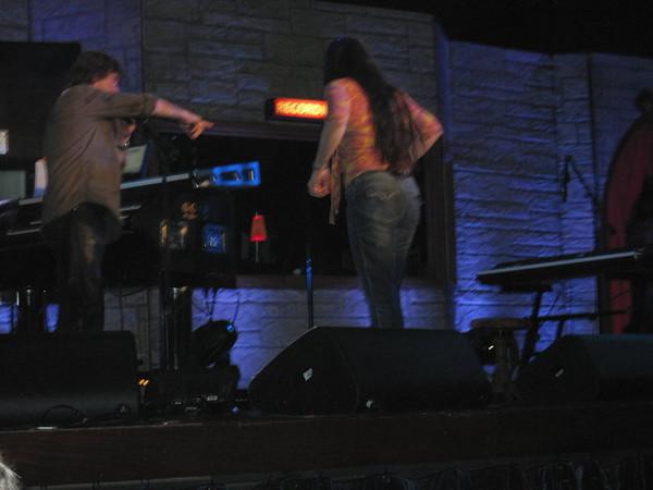 Deb climbing up onstage.