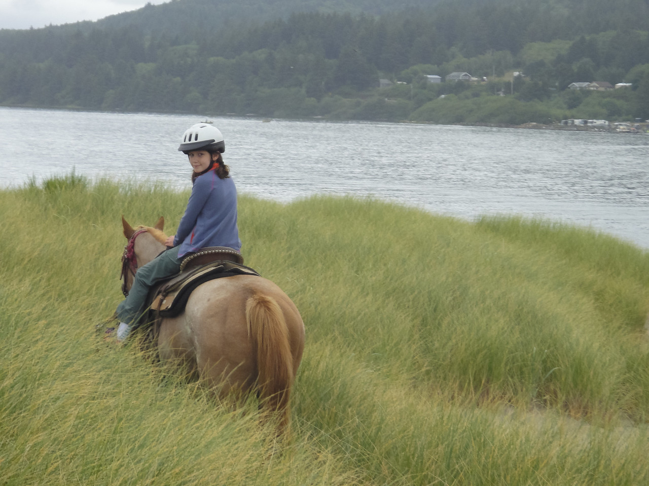 Ruby and Anne horseback riding along the beaches of Oregon.
