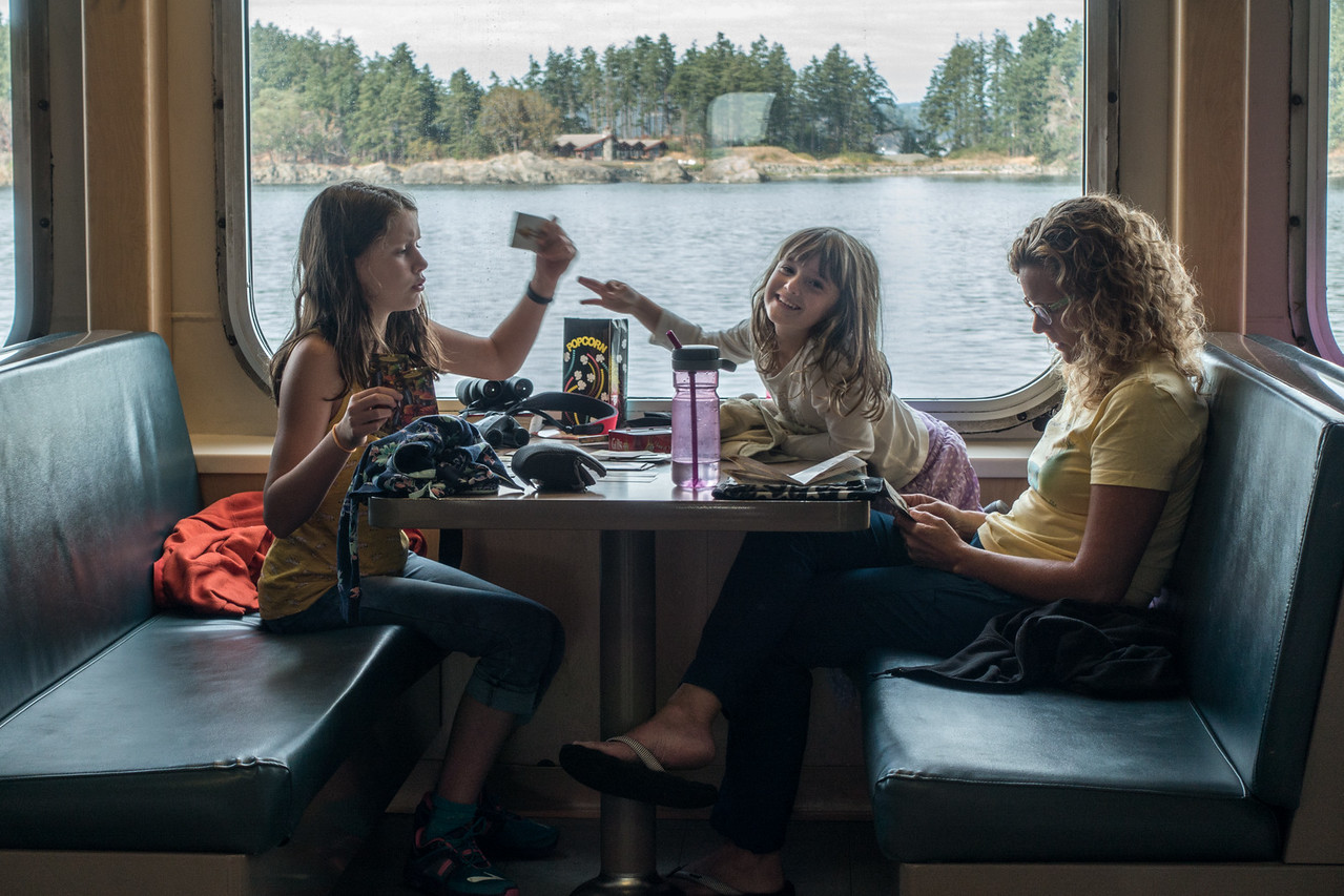 A rare glimpse of the girls on a ferry, during a serious match of Gubs.