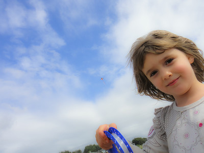 Naomi happy to get her kite up finally.