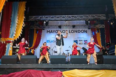 Asli Baharan Punjob Diyan dancers perform with Juggy D at the Vaisaki Festival in Trafalgar Square
