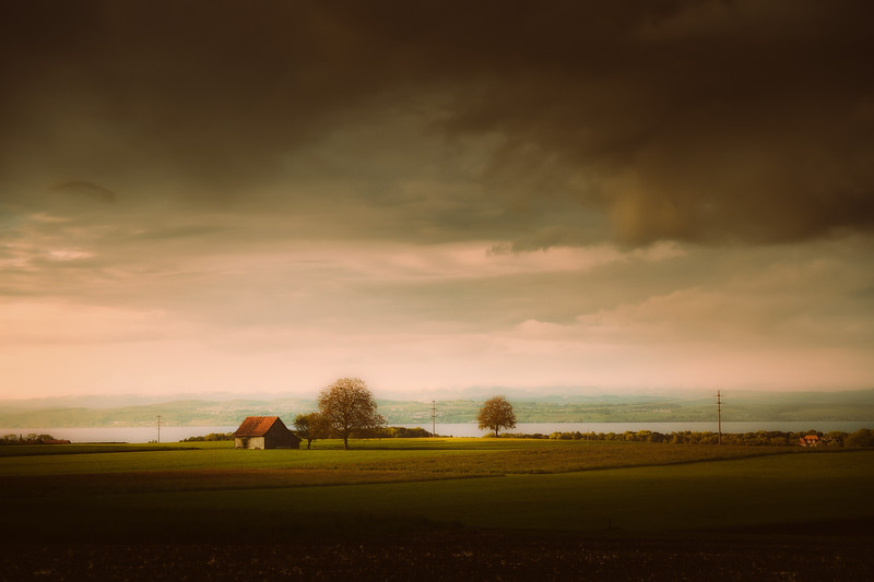 Dark clouds and warm light over Lake Constance