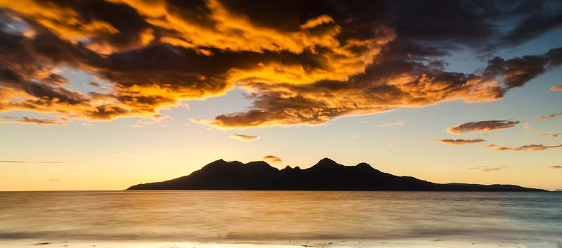Firey sunset over the Isle of Rum. View from Eigg.