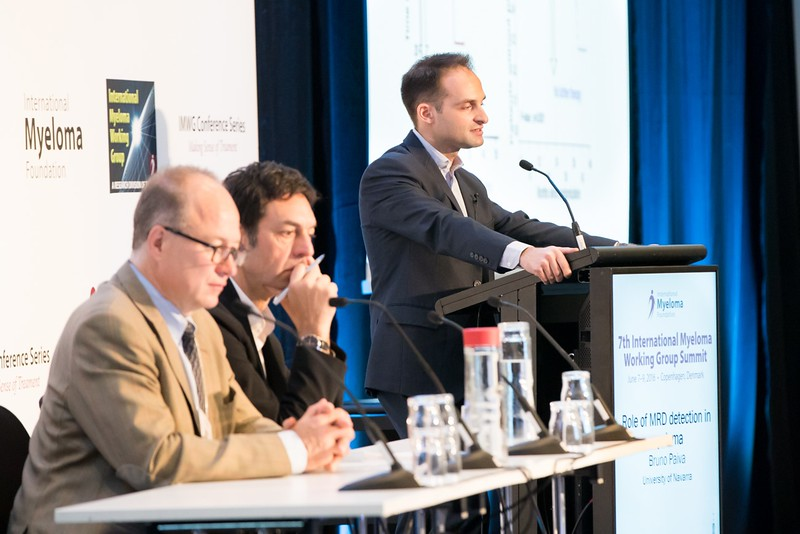 Dr. Paul Richardson and Dr. Philippe Moreau (seated) with Dr. Bruno Paiva (at podium)