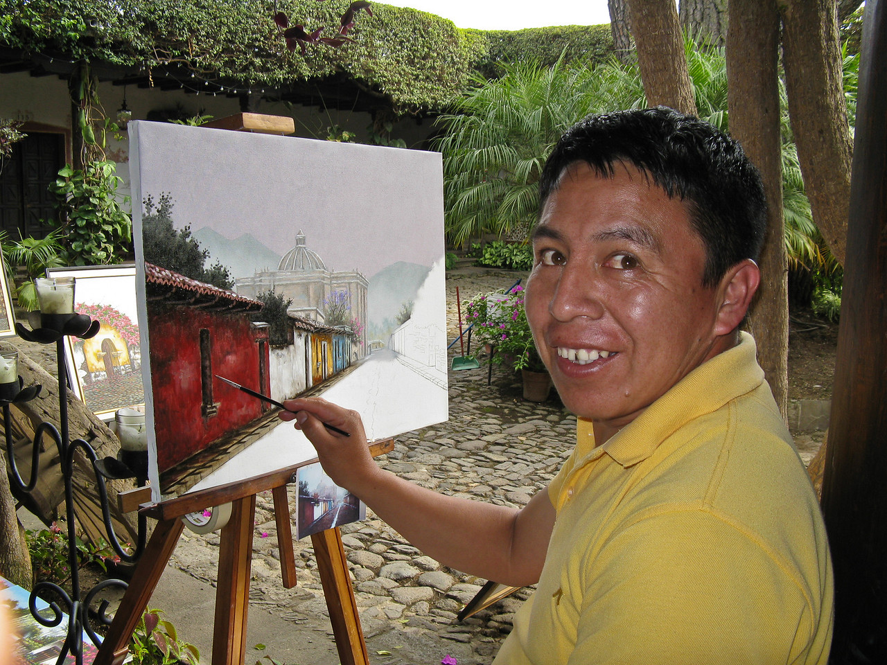 An artist with his work in La Antigua, Guatemala.