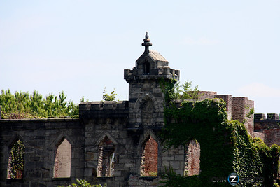 """Renwick Smallpox Hospital  The Renwick Smallpox Hospital(later theMaternity and Charity Hospital Training School) was located on Roosevelt Island in New York City. When Renwick Smallpox Hospital opened on December 18, 1856 on Blackwell's Island (the island's name at the time), the hospital could treat 100 patients. Designed in the style of Gothic Revival, the Smallpox Hospital was strategically positioned in an undeveloped area at the southern tip of the island. The facility was a three-story, """"U-shaped"""" structure complete with two large wings and a front façade at the center. All of the windows on top floor had distinguishing pointed arches rather than curves. Even with the smallpox vaccine, New York City had large outbreaks, in part due to the large immigrant population travelling to the New World. Before the Smallpox Hospitals, victims of the disease received care in what was described as """"a pile of poor wooden out houses on the banks of the river."""" Renwick Smallpox Hospital's remote location was chosen to isolate and quarantine patients, but due to the seriousness of the disease, the hospital had both a large charity ward (on the lower floors) as well as private rooms (on the top floor). In 1875, the Renwick Smallpox Hospital closed, and with its affiliation to City Hospital, it became a training center for nurses (and later renamed Charity Hospital). The hospital focused on academic training after a new hospital was built on North Brothers Island to treat smallpox and other similar diseases. Between 1903 and1905 the two wings were added to the Renwick facility to accommodate the school, officially renamed the Home for the Nurses and the Maternity and Charity Hospital Training School. In 1921 Blackwell's Island was renamed Welfare Island. Over the years, many of the buildings began to deteriorate into total disrepair. In the 1950s, both Charity Hospital and the nursing school were closed, and these operations moved to a new location in Queens, New York. In 1972,"""