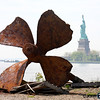 "Remains of the ferry boat ""Ellis Island"" Shuttled passengers to NYC after they were cleared on the island. The boat was recently raised and this is all that remains. (Statue of Liberty in Background)"