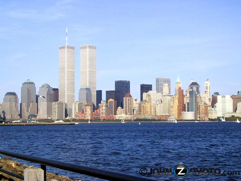 World Trade Center - I took these pictures on September 9th, 2001<br /> <br /> Living just a few miles away from New York City my entire life, the statue of liberty and twin towers were a common daily site for me. One day I decided to take a walk with a friend along the waterfront in Liberty State Park.  At the time, I only owned a point and shoot camera.  I carried it around with me the entire day without taking any pictures.  Before leaving for the day, I turned around to my friend and joked that I felt it was a waste that I hadn't taken a single picture. These were the only 2 pictures I took that day.  Little did I know, these were the first and last pictures I would ever take of the twin towers.  They were taken on September 9th, 2001.
