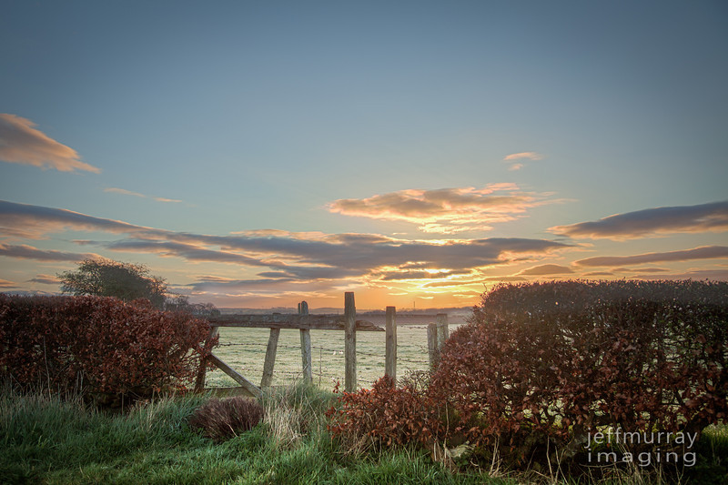 A farm fence in Newton Mearns sillouetted against the sunrise.