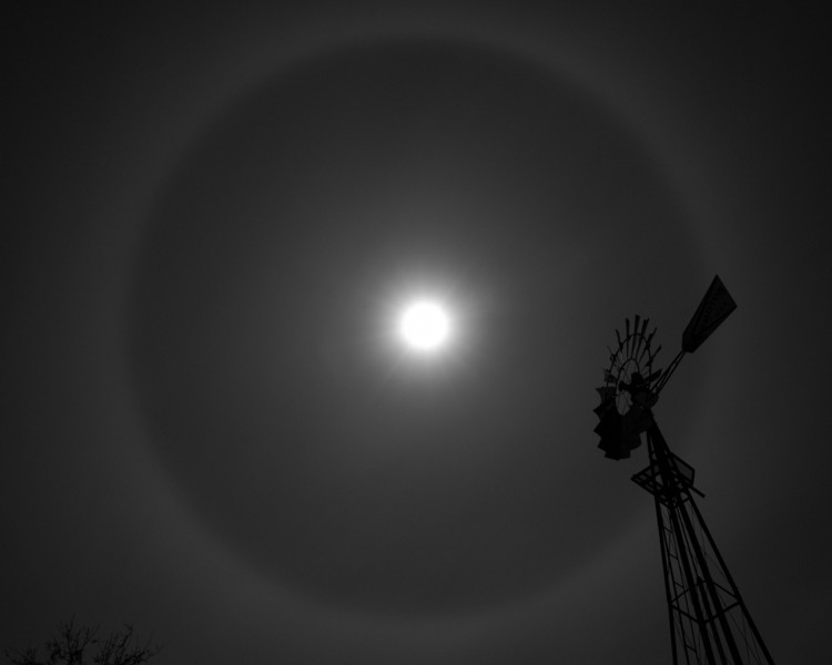 A halo around the full moon foretells of a coming storm.  The chance of rain is a pillar of hope for ranchers in this parched landscape