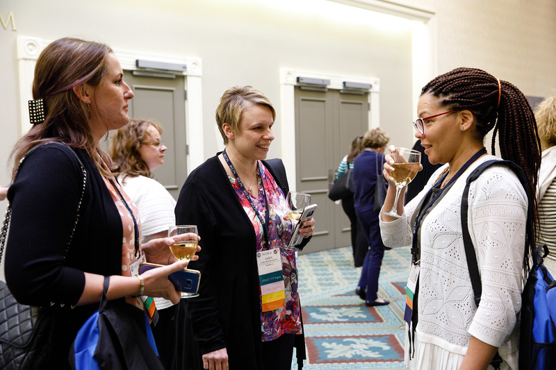 Attendees talk during reception