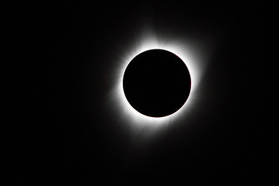 The  Sun's corona is visible during totality.