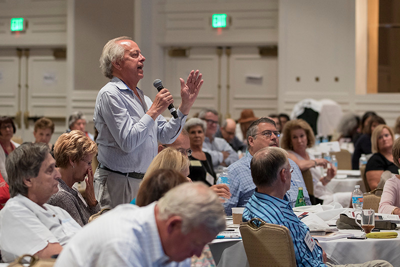 A patient asks a question from the audience.