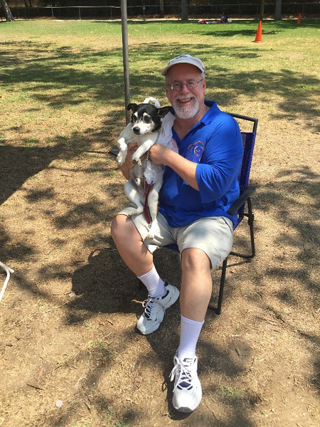 The IMF's Accountant Phil Lange takes a break from number-crunching to chill with his best friend Oreo