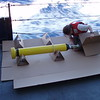 Deploying a float without stopping the ship requires special boxes to protect the floats. Here cross braces are assembled to protect the antenna on the RV Melville (photo by Capt. Maury)
