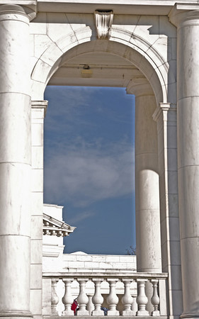 Looking through the arch at the blue sky over the amphitheatre outside the Tomb of the Unknown Soldier