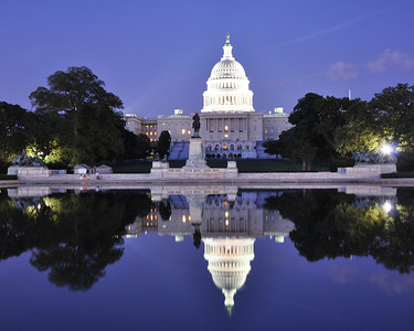 The reflecting pool in front of the US Capitol at dusk