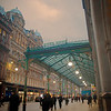 A shot in rush hour at the front front of Glasgow Central Station.<br /> <br /> It's an HDR as the light was a little challenging between the bright canopy and lovely yellow lights on the building opposite.<br /> <br /> I love coming out here first thing in the morning - it's like I am living a Century ago.  Sometimes with the transport system here I feel I am!  On a clear day your often greeting with a lovely band of golden morning light picking the detail on the buildings opposite.