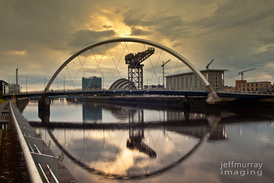 The squinty bridge frames the Armadillo, and Finnieston Crane