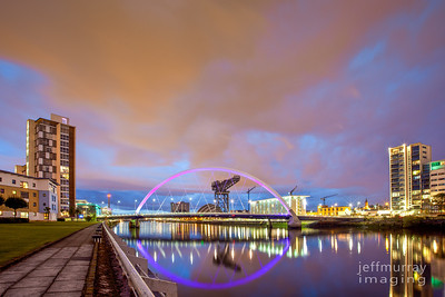 The Clyde Arc frames the Armadillo, and Finnieston Crane (1926) after sunset.    http://en.wikipedia.org/wiki/Finnieston_Crane
