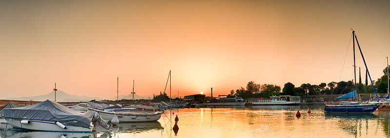 The marina in Peschiera is a spectacular place to leave your boat.<br /> <br /> Surrounded by 16th Century fort walls and right at the entrance to the moat - it is tranquil and picturesque.<br /> <br /> A view over to Mt Baldo at sunrise topped off a lovely morning for me.