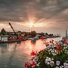 A crane barge moored in Peschiera at sunset.