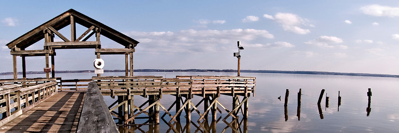 Reflection of the old pilings in the calm waters of the Potomac from the Fishing Pier at Leesylvania State Park