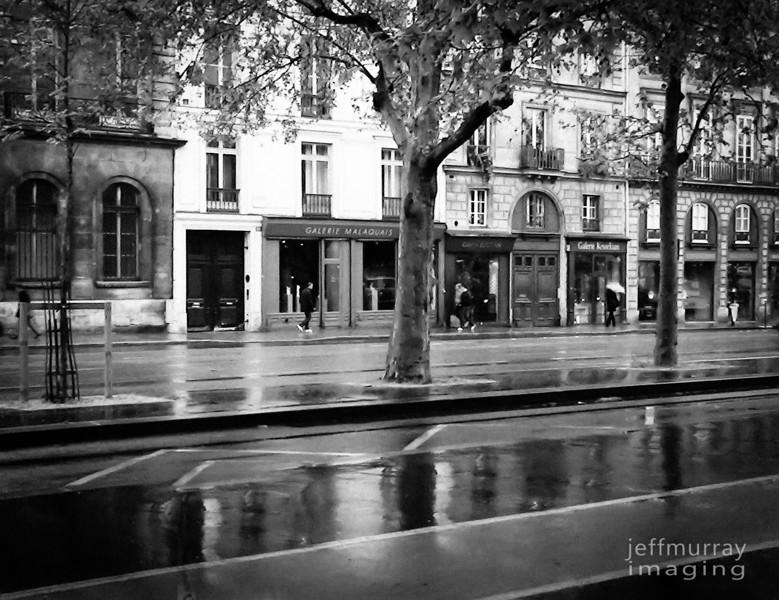 Reflections along Quai de Conti after the Parisian shower.