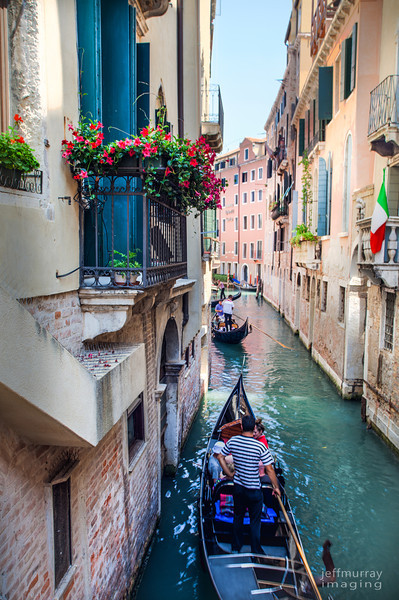 A canal ride on a Gondola for some lucky tourists.