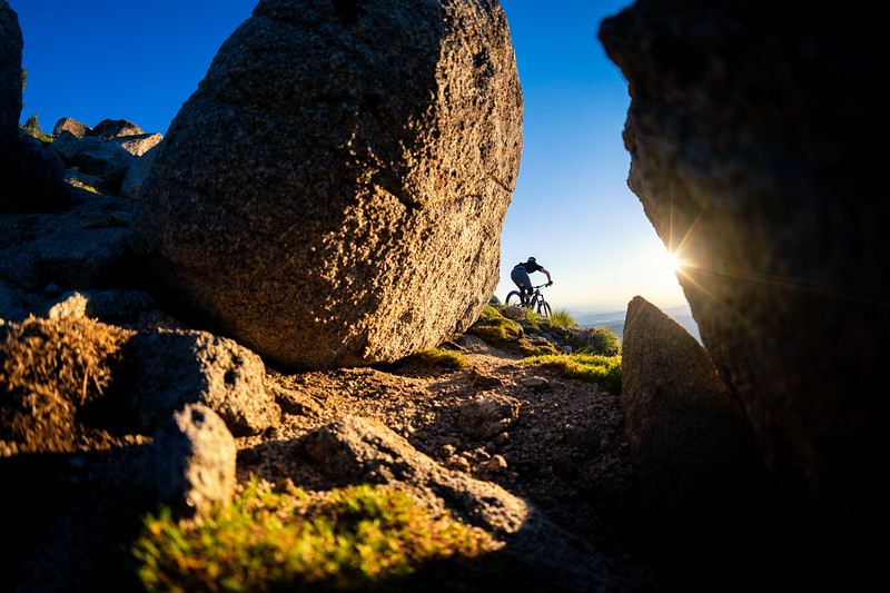 Jason Schroeder shreds the Tempest Trail at Bogus Basin on his mountain bike at sunset.