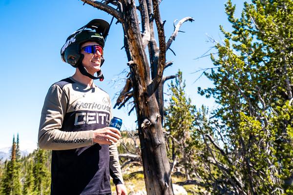 Jason Schroeder enjoys an icy cold Fat Tire beer while mountain biking near Stanley Idaho.