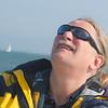 Captain Joe checks out the wind direction as we sail toward Alcatraz in the San Francisco Bay.
