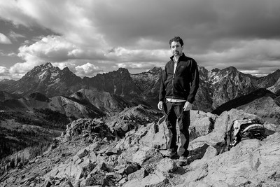 Self-portrait on top of Earl Peak in the Central Cascades. There wasn't much else to do after I summoned the perfect cloud cover, but chill and take some shots. Behind me is The Enchantments and to the left is Mount Stuart