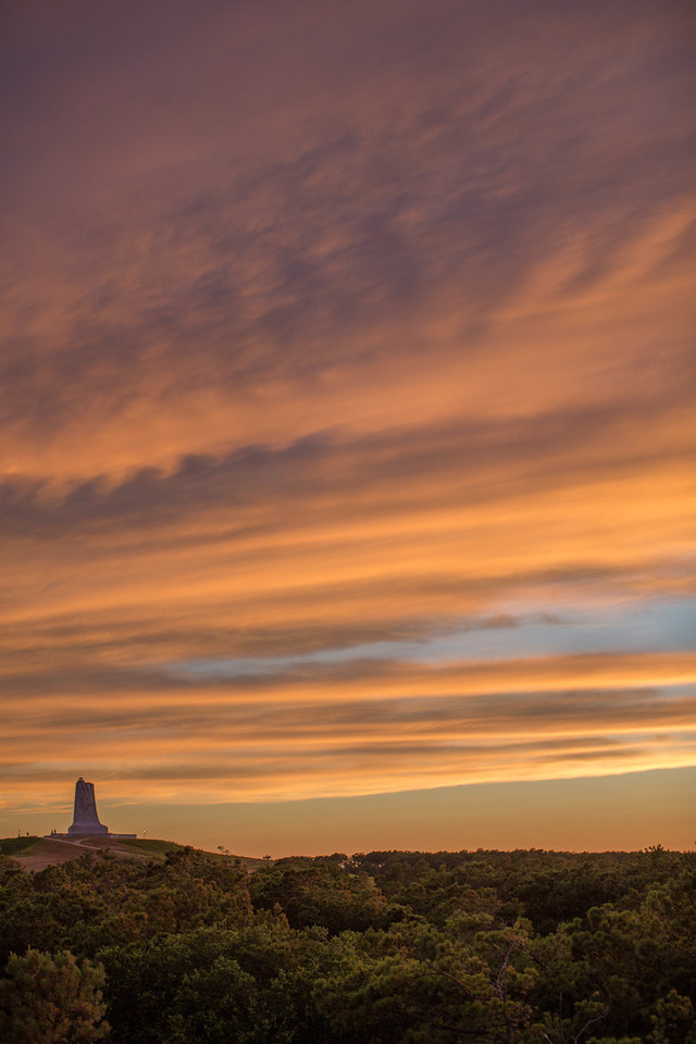 Sitting on our deck looking at a colorful sunset over the Wright Brothers monument.  Makes me wonder what it was like in 1903 when this island and Kill Devil Hills were still so raw and undeveloped.