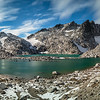 Near the top of Aasgard pass in the upper Enchantments basin, looking out across Tranquil lake and Isolation lake toward Dragontail peak. <br /> <br /> This shot is a panorama of 6 vertical shots using a Singh-Ray polarizer and 5-stop ND filter.