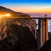 Cars on Bixby Bridge at Sunset