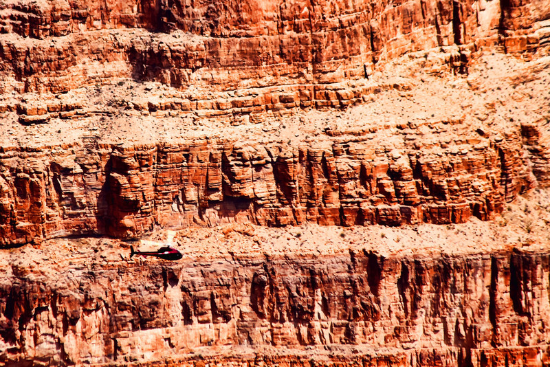 Tour helicopter flies through the Grand Canyon below Guano Point
