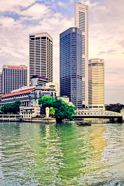 Another example of how Singapore has changed in the last 20 years. This is how the Battery area of Singpore looks in 1989 with the Singapore river flowing under the bridge at right and the Merlion overlooking the confluence of the Singapore River and Kalleng River.