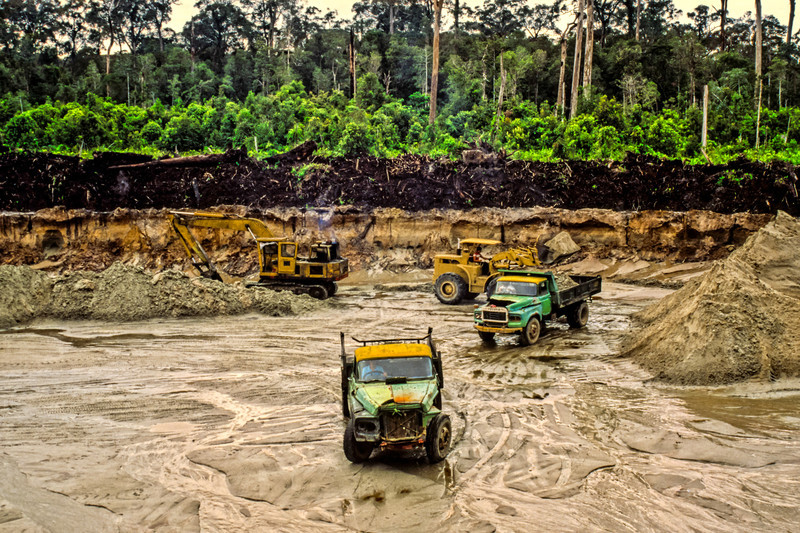 A few miles inland from Kuala Belait, Brunei, was a sand quarry in the jungle. This photo quite clearly shows the 3 ~ 4 meter layer of organic material from the jungle overlying a seam of sand that is being quarried for construction needs.