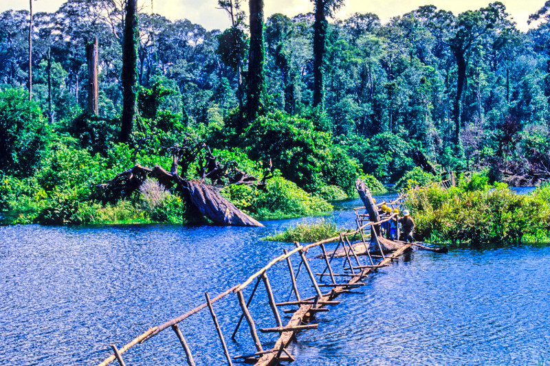 In this photo of lake bridging, part of my crew head home at the end of the day. Brunei, 1989.