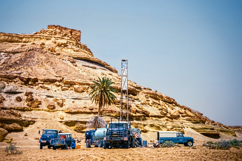 Drilling crew below a jebel in Concession 20