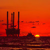 The sun sets behind a jackup rig working off Brunei in 1989
