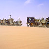Four Birdwagen MarkIV buggies with failing Y2700 vibrators roll into position for another sweep. Calanscio Sand Sea, eastern Libya. 1990.