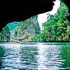 Emerging from the inside of a 'Hong' and heading back to our boat in Phang Nga Bay, Thailand, 1991. The Hong is the inside of an island. Entrance is by way of caves that run through to the sea on the other side of the rock walls.