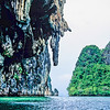 Paddling around the base of a karst limestone island in Phang Nga Bay, Thailand, 1991. The Hong is the inside of an island. Entrance is by way of caves that run through to the sea on the other side of the rock walls.
