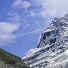 A hiker descends the trail with the Jungfrau in the background