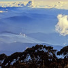 The view south from the helipad at Laban Rata as the sun descends to the west. Mount Kinabalu. 1989