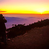 A fellow hiker shoots the sun setting over the South China Sea from the helipad at Laban Rata. Mount Kinabalu. 1989.